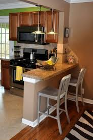 Kitchens  White Modern Kitchen With Wood Breakfast Bar Table And - Kitchen breakfast bar tables
