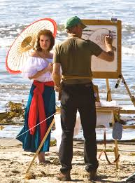 file painter with his beautiful female subject in spanish dress