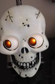 vintage skull wall door greeter plaque halloween animated eyes