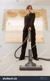 young woman business suit vacuuming exaggerated stock photo