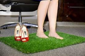 a green space with an artificial grass rug bestfakegrasses com