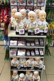 pope francis souvenirs bobblehead umbrella mug or magnet pope souvenirs abound the
