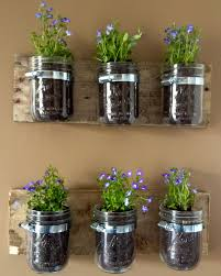 planters that hang on the wall diy hanging wall planters from mason jars kasey trenum