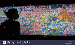 london uk 18 november 2015 wellcome collection employees look wellcome collection employees look at the the lukhang murals from the meditation chamber in the lukhang taken by photographer thomas laird