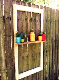 window we hung on the privacy fence with a window box