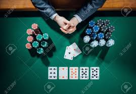 poker table top and chips poker player s hands with cards and stacks of chips all around