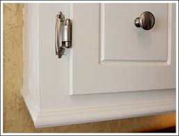 how to add trim to bottom of kitchen cabinets add molding to the bottom of your cabinet home diy