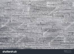 grey stone wall background stacked stone stock photo 574316881