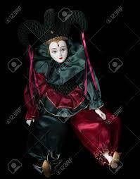 mardi gras doll mardi gras doll clown isolated on black background stock photo