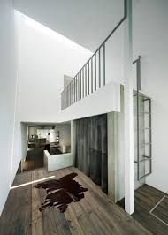 interior concrete walls narrow urban home with concrete walls and upper bridge