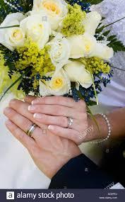 wedding flowers groom wedding flowers rings and groom holding by