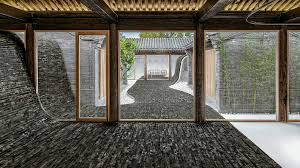 homes with interior courtyards this mind blowing home s undulating courtyard lifts up to form