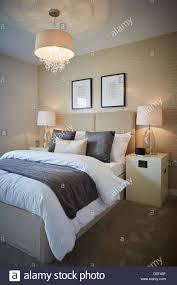 show home interior main bedroom cream magnolia print stock
