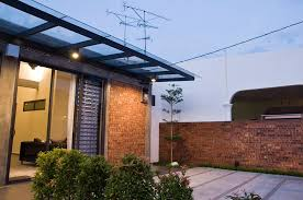 single storey terrace house with a raw exterior design while