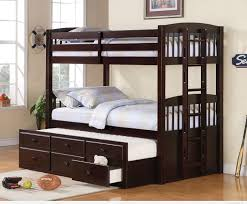 black wooden bunk bed with stairs added by some drawers under the