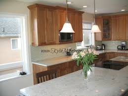 kitchen cherry cabinets full height light green glass backsplash