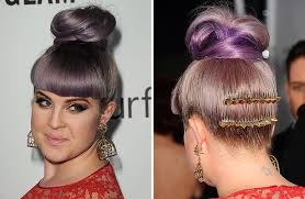 kelly osbourne clashes in red dress and purple hair at christmas