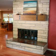 interior rustic fireplace mantels with red wall and stone wall
