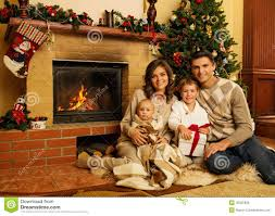 family near fireplace in christmas house stock photo image 45035836