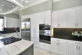 are white or kitchen cabinets more popular shaker sarasota kitchen in chalk white silk and painted grey