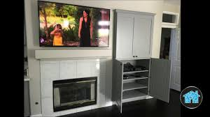 family room surround sound with tv over fireplace youtube