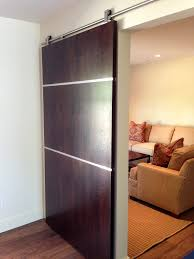 Steel Sliding Barn Doors by Brown Wooden Sliding Barn Door With Silver Steel Track On White