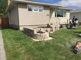 front yard belvedere retaining wall in fon du lac the lawn salon