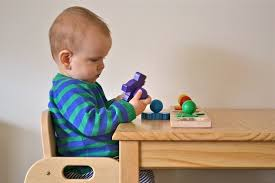 baby standing table toy working sitting standing at his table how we montessori