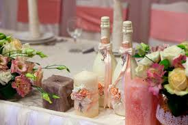 table decorations with candles and flowers decorated chagne bottles candles and flowers on wedding table