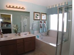 theme mirror brown wooden bathroom vanity with white top and large mirror on