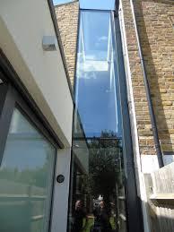 frameless glass window seats and vertical frameless glass windows