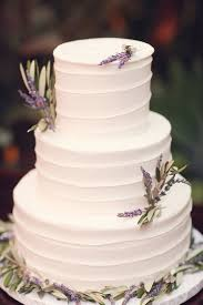 wedding cake lavender picture of white frosted wedding cake with lavender sprigs