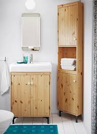 corner cabinet small bathroom a small bathroom with a sink cabinet and a corner cabinet in light