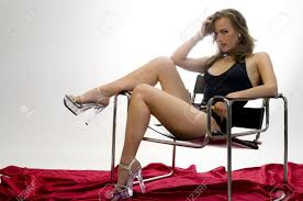 leggy model draped across a modernist chair stock photo picture