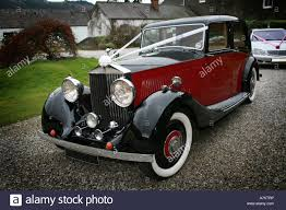 wedding rolls royce red and black vintage rolls royce wedding car with typical white