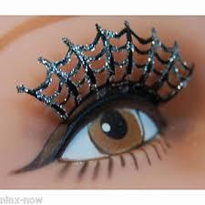 false eyelashes spider web black with silver glitter adhesive