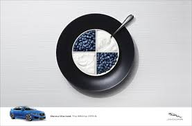 bmw logos jaguar devours german rivals u0027 logos with creative print ads
