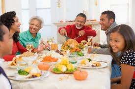 an american family enjoying their thanksgiving dinner