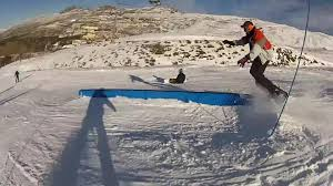 snowboarder crashes and flips over rail jukin media