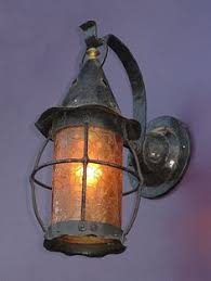tudor style exterior lighting storybook or tudor style porch light with yellow pebble glass