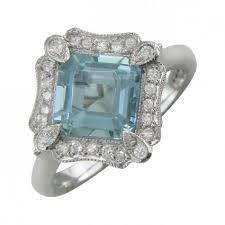 aquamarine ring with surrounding diamonds vintage style