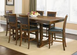 rustic dining table with narrow dining table have some plates and