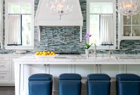 the pros and cons of glass mosaic and natural stone backsplashes