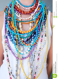 coloured bead necklace images Young woman wearing multi coloured beads and necklaces stock photo jpg