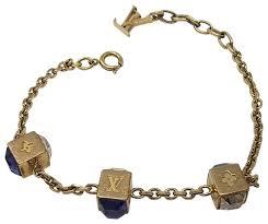 charm bracelet louis vuitton gold purple blue gold tone gamble lv charm