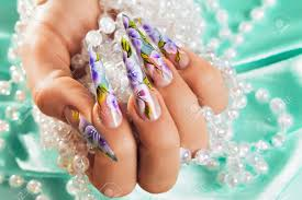 female hand with beautiful floral design on nails stock photo