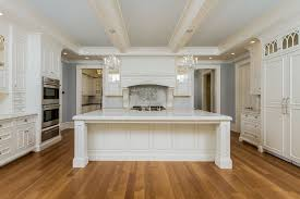 kitchen island molding traditional kitchen with high ceiling flat panel cabinets in