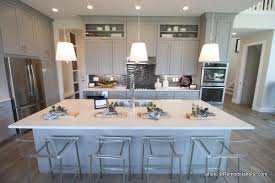 white kitchen cabinets with light grey backsplash remodelaholic 40 beautiful kitchens with gray kitchen cabinets