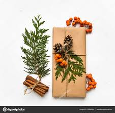 gift box in craft paper on white background christmas or other