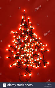 String Christmas Tree Lights by Christmas Tree Design Made From String Of Lights On A Red